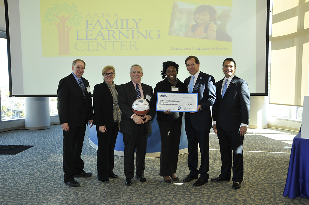 (left to right) Robert R. McCormick Foundation Communities Program Director Bill Koll; Magic Vice President of Philanthropy and Multicultural Insights Linda Landman Gonzalez; Apopka Family Learning Center CEO Dr. John Manning; Apopka Family Learning Center Development Director Valynn Sala-Diakanda; Magic Chairman Dan DeVos; Magic CEO Alex Martins at the 2014 Orlando Magic Youth Fund All-Star grant ceremony in January.  The OMYF-MFF distributed grants totaling $600k to 25 nonprofit organizations in Central Florida including $15,000 to Apopka Family Learning Center. Photo taken by Gary Bassing.